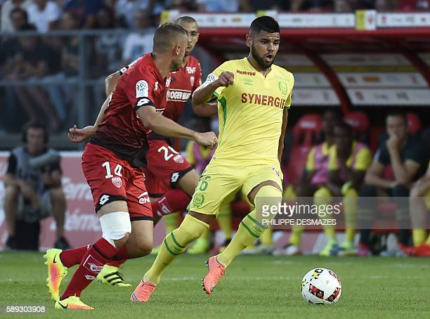 Dijon's French midfielder Jordan Marie vies with Nantes' Brazilian defender Lima during the French L1 football match Dijon FCO against FC Nantes on...