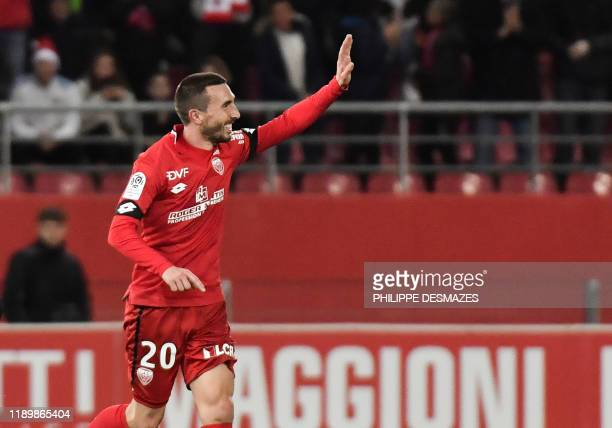 Dijon's French midfielder Romain Amalfitano celebrates after scoring a goal during the French L1 football match between Dijon Football Cote-d'Or and...