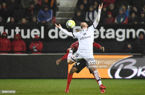 Dijon's French midfielder Romain Amalfitano vies with Guingamp's French defender Marcus Coco during the French L1 football match Guingamp vs Dijon on...