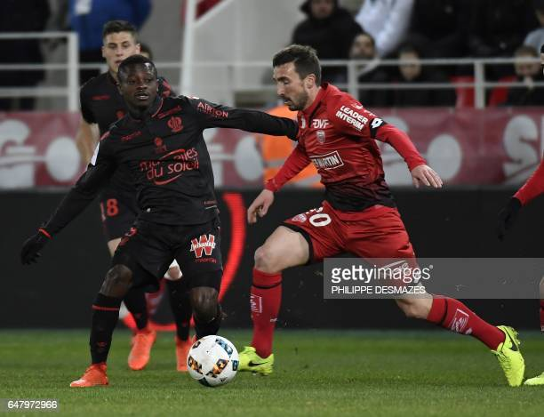 Dijon's French midfielder Romain Amalfitano vies with Nice's French midfielder Wylan Cyprien during the French L1 football match Dijon against OGC...