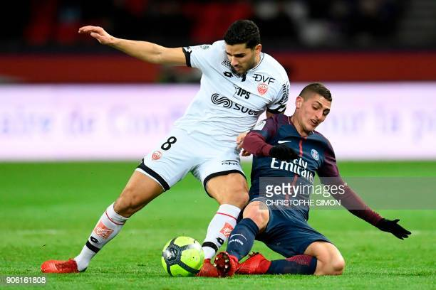 Dijon's FrenchAlgerian midfielder Mehdi Abeid and Paris SaintGermain's Italian midfielder Marco Verratti go for the ball during the French L1...