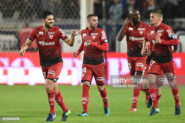 Dijon's FrenchAlgerian midfielder Mehdi Abeid celebrates with teammates after scoring a goal during the French L1 football match between Bordeaux and...