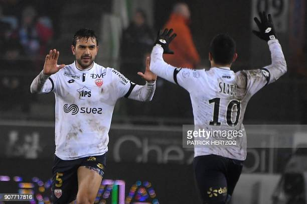 Dijon's FrenchAlgerian midfielder Mehdi Abeid celebrates with Dijon's FrenchTunisian midfielder Naim Sliti after scoring a goal during the French...