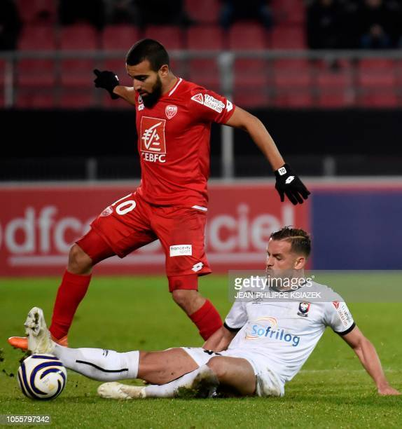 Dijon's FrenchTunisian midfielder Naim Sliti vies with Caen's French defender Jonathan Gradit during the French League Cup football match between...