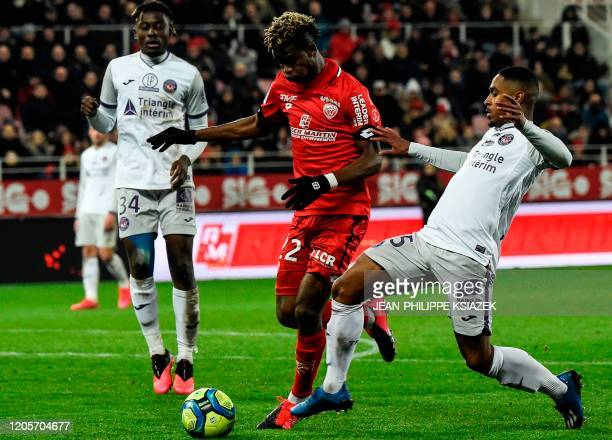 Dijon's Gabonese midfielder Didier Ndong fights for the ball with Toulouse's French forward Wesley Said during the French L1 football match between...