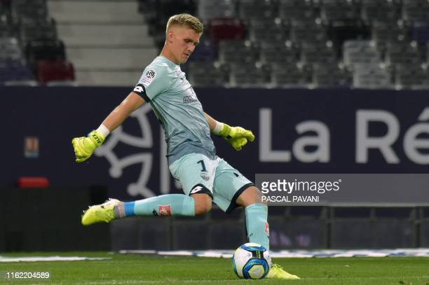 Dijon's Icelandic goalkeeper Runar Runarsson kicks the ball during the French L1 football match between Toulouse and Dijon on August 17, 2019 at the...