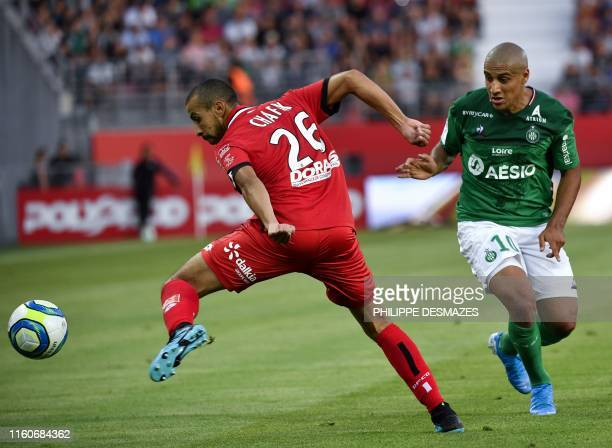 Dijon's Moroccan defender Fouad Chafik fights for the ball with Saint-Etienne's Tunisian midfielder Wahbi Khazri during the French L1 football match...