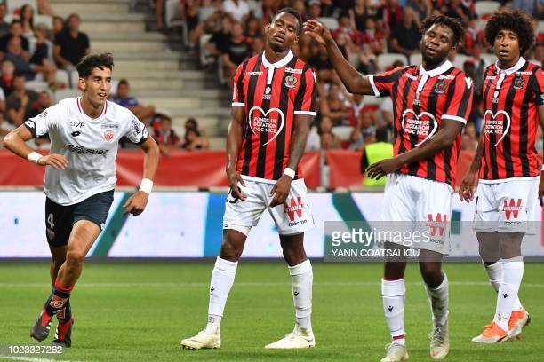 Dijon's Moroccan defender Nayef Aguerd celebrates after scoring a goal during the French L1 football match between Nice and Dijon on August 25 2018...