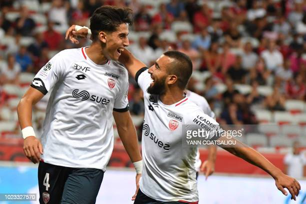 Dijon's Moroccan defender Nayef Aguerd celebrates with Dijon's Tunisian forward Naim Sliti after scoring a goal during the French L1 football match...