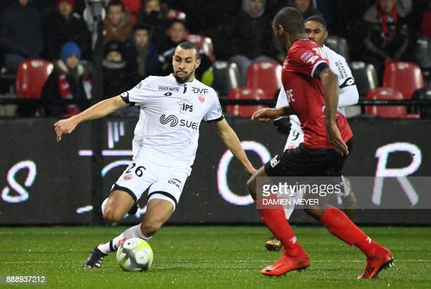 Dijon's Moroccan midfielder Fouad Chafik vies for the ball during the French L1 football match between Guingamp and Dijon at the Roudourou Stadium in...