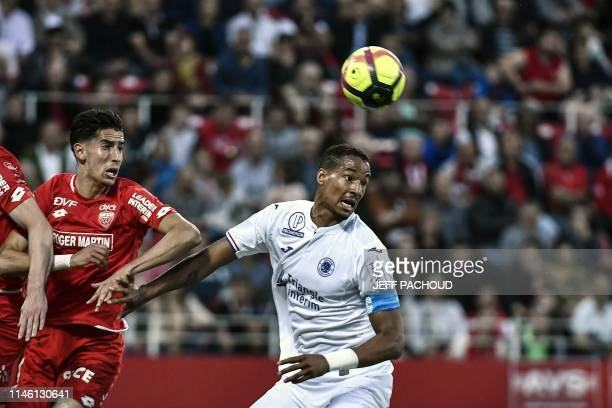 Dijon's Morrocan defender Nayef Aguerd vies with Toulouse's French defender Christopher Jullien during the French L1 football match between Dijon and...
