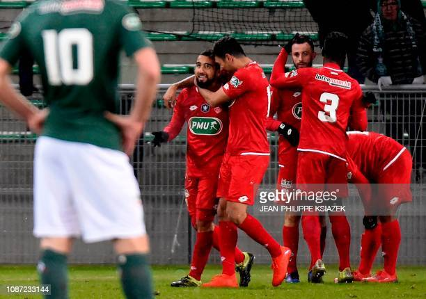 Dijon's players celebrate after scoring a goal during the French Cup round of 32 football match between SaintEtienne and Dijon on January 23 2019 at...