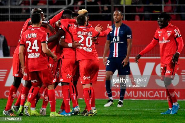Dijon's players celebrate after scoring a goal during the French L1 football match between Dijon Football Cote-d'Or and Paris Saint-Germain on...