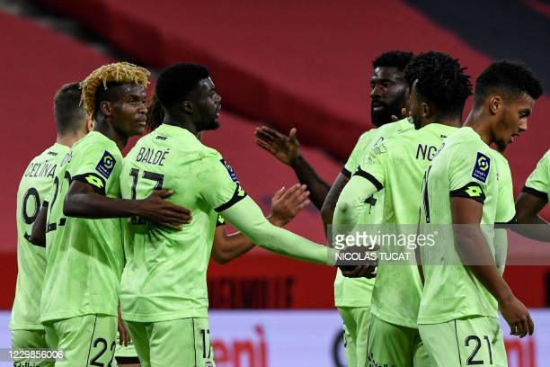 Dijon's players celebrate after scoring a goal during the French L1 football match between Nice and Dijon at The Allianz Riviera Stadium in Nice,...