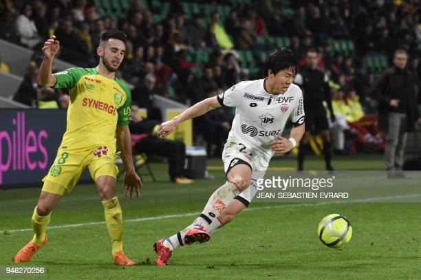 Dijon's South Korean midfielder Chang Hoon Kwon runs with the ball during the French L1 football match between Nantes and Dijon on April 14 at the...