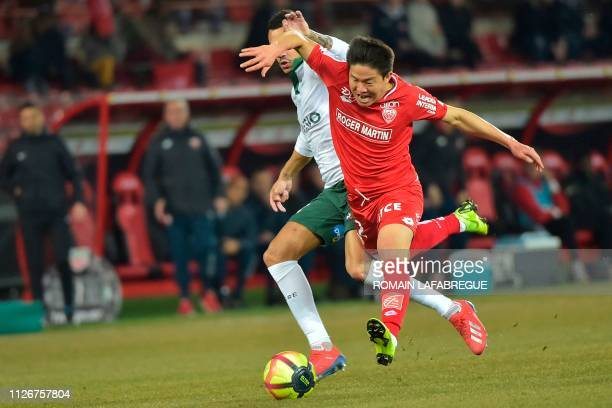 Dijon's South Korean midfielder Kwon Chang-hoon vies with Saint-Etienne's French midfielder Thimothee Kolodziejczak during the French L1 football...