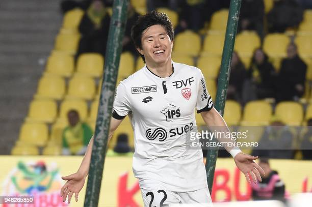 Dijon's SouthKorean midfielder Chang Hoon Kwon celebrates after scoring during the French L1 football match between Nantes and Dijon on April 14 2018...