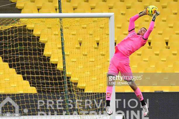 Dijon's Swiss goalkeeper Anthony Racioppi makes a save during the French L1 football match between FC Nantes and Dijon at the La Beaujoire Stadium in...