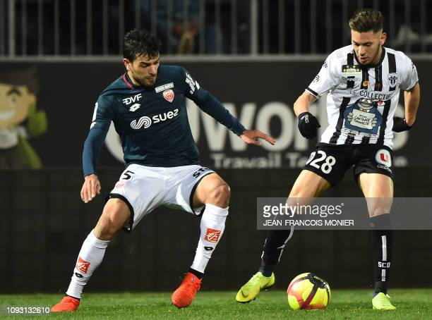 Dijon's Tunisian defender Oussama Haddadi vies with Angers' Algerian forward Farid El Melali during the French L1 football match between Angers and...