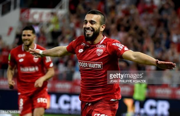 Dijon's Tunisian forward Naim Sliti celebrates after scoring a goal during the French L1-L2 second leg play-off football match between Dijon and Lens...