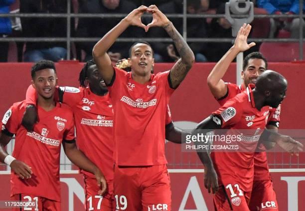 Dijon's Venezuelan forward Jhonder Cadiz celebrates with teammates after scoring a goal during the French L1 football match between Dijon Football...