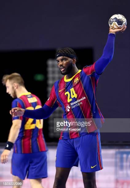 Dika Mem of FC Barcelona passes the ball during the VELUX EHF Champions League FINAL4 semi-final between FC Barcelona v HBC Nantes at Lanxess Arena...