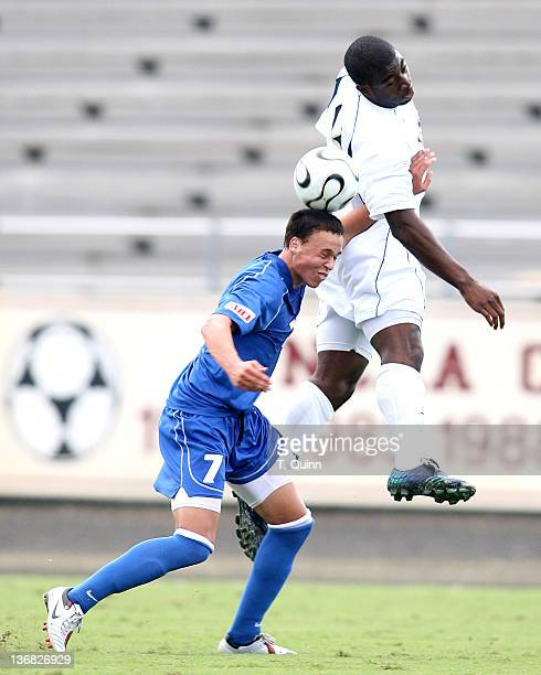 Dike Bright raise high over Rob Viviano to head down the ball. After double over time Notre Dame and St. Louis University had to settle for a 0-0 tie...