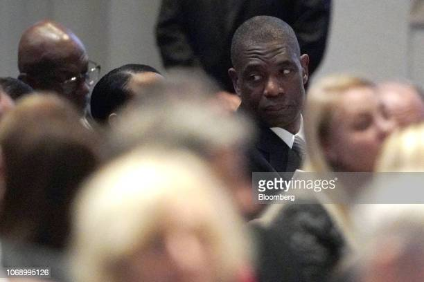 Dikembe Mutombo a former professional basketball player with the National Basketball Association's Houston Rockets attends a funeral service for...