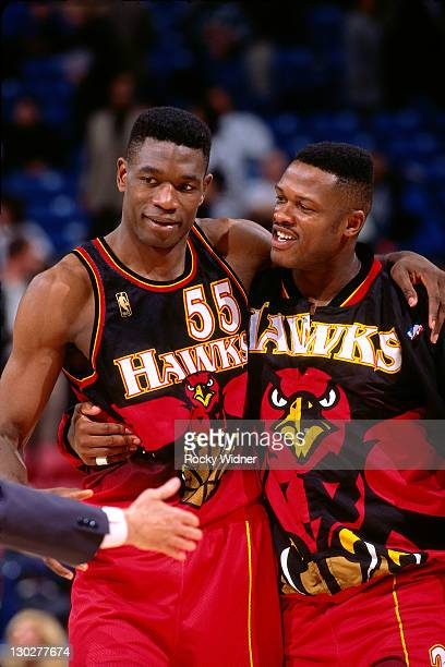 Dikembe Mutombo and Andrew Lange of the Atlanta Hawks against the Sacramento Kings on November 7 1996 at Arco Arena in Sacramento California NOTE TO...