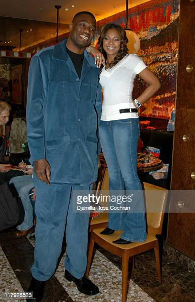 Dikembe Mutombo and Ashanti during New York Knicks' Read to Achieve Pledge Kickoff with Ashanti and Rocco DiSpirito at Rocco's in New York City New...