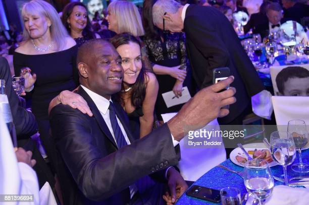 Dikembe Mutombo and Dolores Gahan attend 13th Annual UNICEF Snowflake Ball 2017 at Cipriani Wall Street on November 28 2017 in New York City