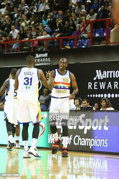 Dikembe Mutombo and Festus Ezeli of Team Africa checks into the game against Team World during the NBA Africa Game 2015 as part of Basketball Without...