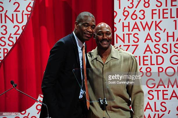 Dikembe Mutombo and Karl Malone pose for a picture at the Dominique Wilkins Statue Unveiling Ceremony on February 25, 2015 at Philips Arena in...