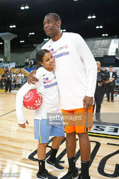 Dikembe Mutombo and Lindsey Harding hug before the NBA Cares Unified Basketball Game as part of 2018 NBA AllStar Weekend at the Los Angeles...