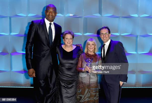 Dikembe Mutombo Caryl M Stern Carol J Hamilton and Nicolas Hieronimus speak onstage during 13th Annual UNICEF Snowflake Ball 2017 at Cipriani Wall...
