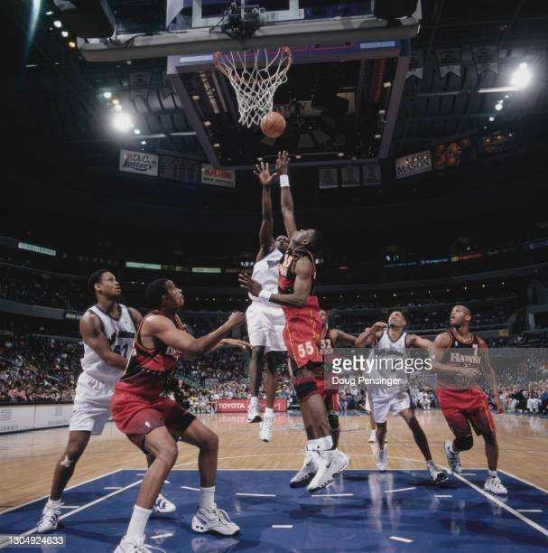 Dikembe Mutombo, Center for the Atlanta Hawks attempts to block the shot of Washington Wizard Point Guard Rod Strickland during their NBA Atlantic...