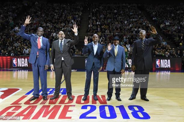 Dikembe Mutombo John Amaechi Richard Hamilton Andre Miller and Robert Parish during the game between the Boston Celtics and the Philadelphia 76ers as...