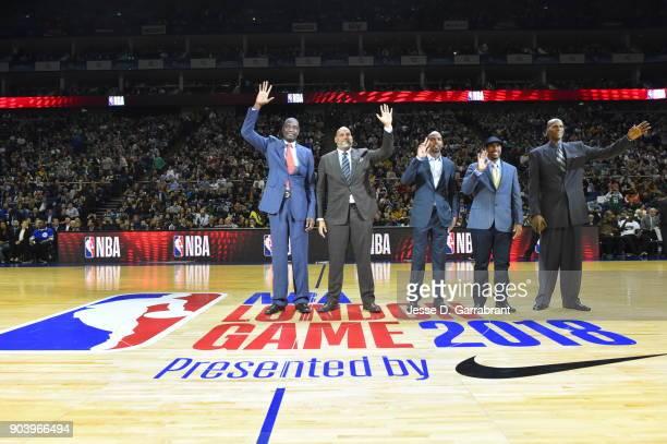 Dikembe Mutombo John Amaechi Richard Hamilton Andre Miller and Robert Parish are seen during the game between the Philadelphia 76ers and Boston...