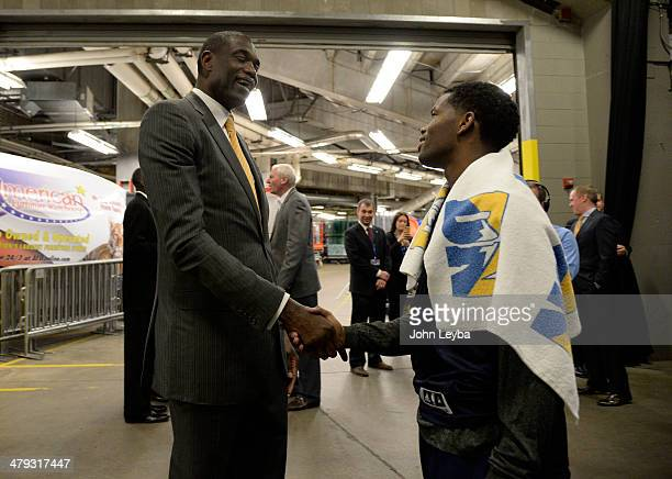 Dikembe Mutombo meets with Denver Nuggets guard Aaron Brooks at halftime March 17 2014 at Pepsi Center The Denver Nuggets celebrated after nearly 20...