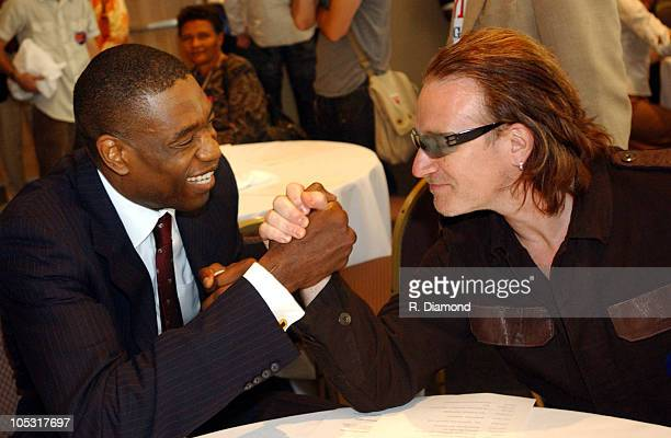 Dikembe Mutombo NY Knicks and Bono during Bono and DATA Announce THE ONE CAMPAIGN at Independence Hall in Philadelphia PA United States