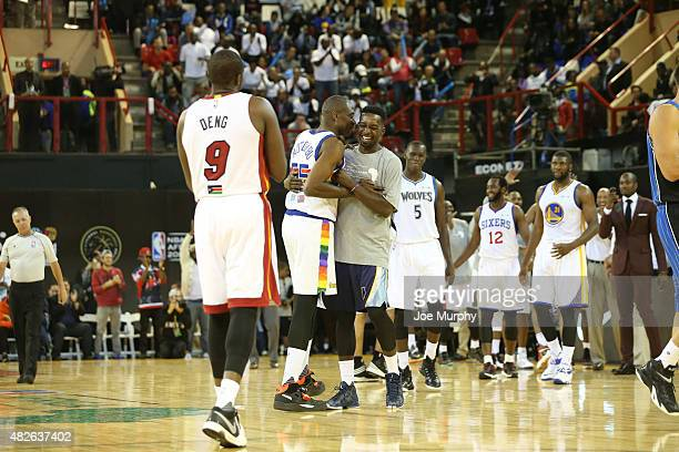 Dikembe Mutombo of Team Africa greets against Jeff Green of Team World during the NBA Africa Game 2015 as part of Basketball Without Boarders on...