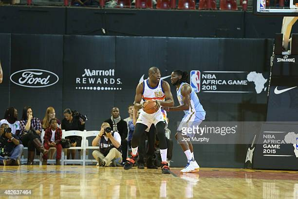Dikembe Mutombo of Team Africa looks to shoot against Kenneth Faried of Team World during the NBA Africa Game 2015 as part of Basketball Without...