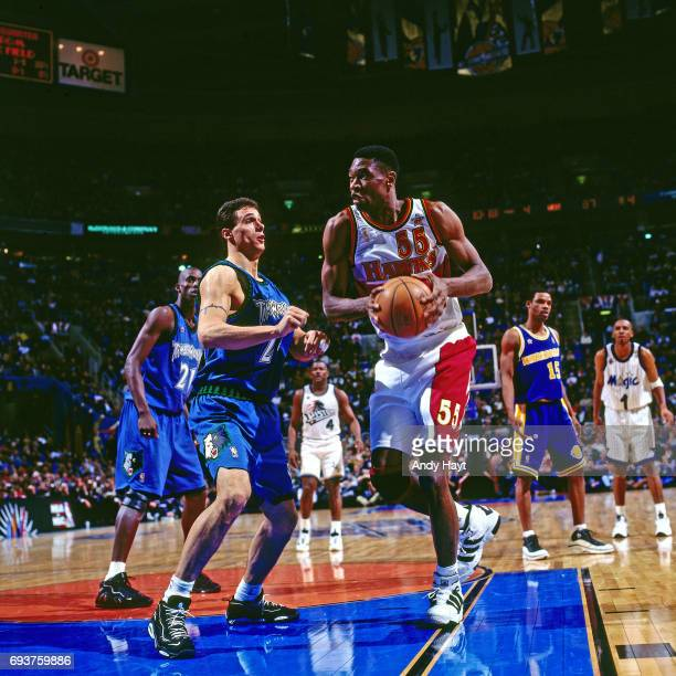 Dikembe Mutombo of the Atlanta Hawks handles the ball during the game during the 1997 NBA AllStar Game played on February 9 1997 at Gund Arena in...