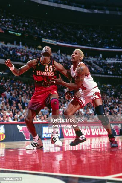 Dikembe Mutombo of the Atlanta Hawks is seen on guard against Dennis Rodman of the Chicago Bulls during the game between the Atlanta Hawks and the...