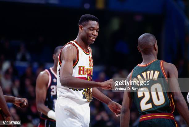 Dikembe Mutombo of the Atlanta Hawks talks with players during the 1997 AllStar Game on February 9 1997 at Gund Arena in Cleveland Ohio NOTE TO USER...