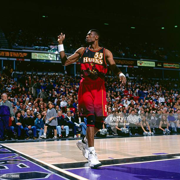 Dikembe Mutombo of the Atlanta Hawks wags his finger during a game played against the Sacramento Kings circa 1998 at Arco Arena in Sacramento...