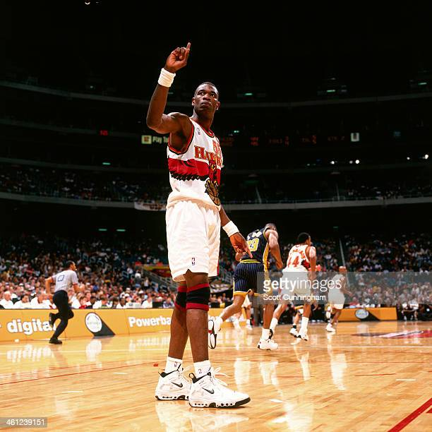 Dikembe Mutombo of the Atlanta Hawks waves his finger after a block shot against the Indiana Pacers at the Georgia Dome on April 9, 1998 in Atlanta,...