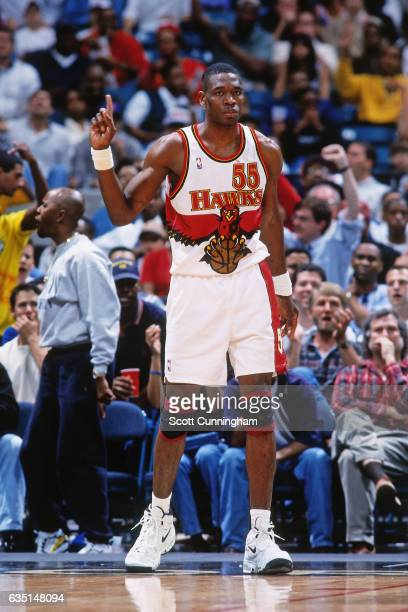 Dikembe Mutombo of the Atlanta Hawks waves his finger against the New York Knicks on April 7, 1998 at The Omni in Atlanta, Georgia. NOTE TO USER:...