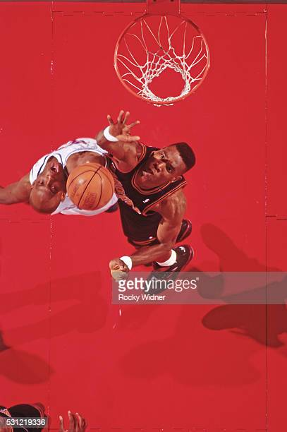 Dikembe Mutombo of the Denver Nuggets blocks a shot during the game against the Sacramento Kings circa 1994 at the ARCO Arena in Sacramento...