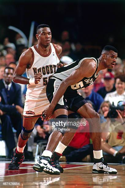 Dikembe Mutombo of the Denver Nuggets defends against David Robinson of the San Antonio Spurs Quarterfinals Game Three of the Playoffs on May 2 1995...